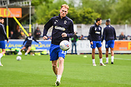 AFC Wimbledon Midfielder Mitchell Pinnock (11) warms-up ahead of during the EFL Sky Bet League 1 match between AFC Wimbledon and Wycombe Wanderers at the Cherry Red Records Stadium, Kingston, England on 27 April 2019.