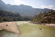 An inflatable boat carrying tourists calmly floating down the Trishuli river on the 3rd of March 2020 near Malekhu Benighat region, Nepal. White water rafting is common with tourists on the Trishuli river due to stunning views,  impressive gorges and exciting rapids, the river is one of the major tributaries of the Narayani River basin in central Nepal. (photo by Andrew Aitchison / In pictures via Getty Images)