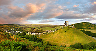 Medieval Corfe castle keep & battlements at sunrise, built in 1086 by William the Conqueror, Dorset England