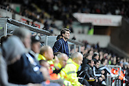 Swansea City Manager Michael Laudrup watches his team late in the second half.<br /> UEFA Europa league match, Swansea city v FC Kuban Krasnodar at the Liberty Stadium in Swansea, South Wales on Thursday 24th October 2013. pic by Phil Rees, Andrew Orchard sports photography,
