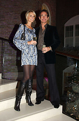 MALIN JOHNANSSON and TIM JEFFERIES at a Christmas party to celebrate the 225th Anniversary of Asprey held at their store 167 New Bond Street, London on 7th December 2006.<br /><br />NON EXCLUSIVE - WORLD RIGHTS