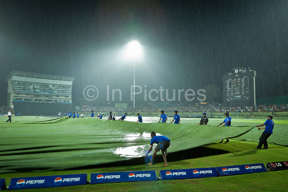 During the 2011 ICC Cricket World Cup in Sri Lanka a heavy downpour stops play  during the match between Pakistan vs Zimbabwe in Kandy.