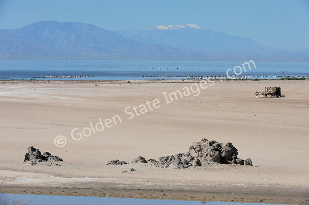 Snow covered Mount San Jacinto in background.<br /> <br /> The Salton Sea continues to shrink due to evaporation. The water which is left is ever more saline.