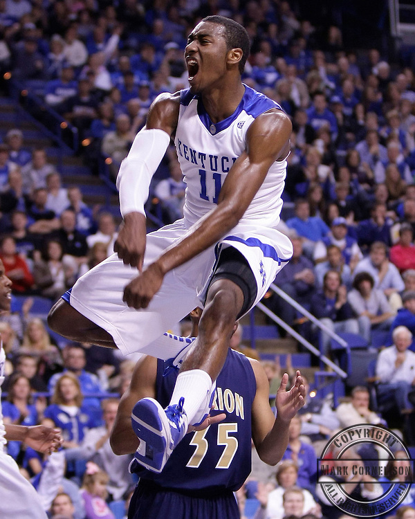 John Wall was jubilant after a first half dunk as  Kentucky played Clarion  on Friday November 6, 2009 in  Lexington, Ky. Photo by Mark Cornelison   Staff