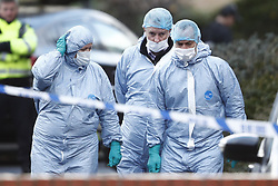 © Licensed to London News Pictures. 03/12/2018. London, UK. Police investigators in protective clothing inspect the scene in Lacock Clise in Wimbledon where a man was shot by police on a pre-planned operation this morning. Photo credit: Peter Macdiarmid/LNP