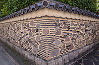 Hakatabei Clay Walls at Rakusui-en  - Rakusui was the pen name of Hakata businessman Mr Chikamasa Shimozawazenemon, who contributed to the development of Fukuoka.  In 1906, Chikamasa built Sumiyoshi villa with a teahouse in this area.  In 1995 the city of Fukuoka remodeled the garden and teahouse and opened the venue and named it Rakusui-en echoing its original name Rakusuian - a place where visitors can experience tea ceremony chado.  Its most famous feature are its distinctive walls. The clay walls are made of reclaimed burnt  roof tiles and rocks and from the war,  called Hakatabei.