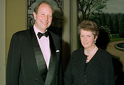 RT.HON.SIR ARCHIBALD & LADY HAMILTON he is the new chairman of the Conservative Party 1922 committee, at a reception in London on 12th June 1997.<br /> LZH 105