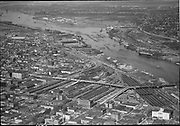 """Ackroyd 01672-2 """"Misc. aerials. August 9, 1949"""" """"Harbor district looking north from Broadway Bridge"""" (note dredges at Swan Island)"""