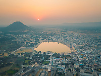 Aerial view of Pushkar town during sunset over the pushkar lake in Ajmer city, Rajasthan, India.
