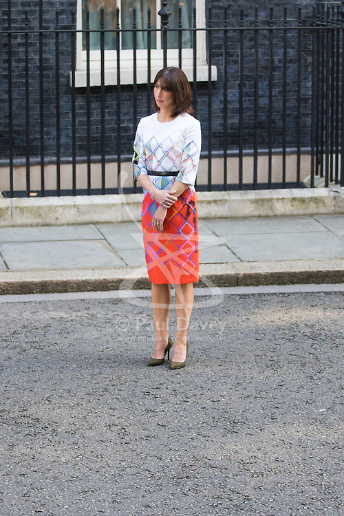 Downing Street, London, June 24th 2016. British Prime Minister David Cameron appears before the world's press gathered in Downing Street and announces that he will step aside with a new Prime Minister in place before the Party Conference, after the country votes to leave the European Union. PICTURED: Samantha Cameron watches her husband announce his resignation as British Prime Minister.