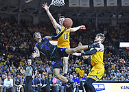 Isaiah Hill #4 of the Tulsa Golden Hurricane gets fouled by Erik Stevenson #10 of the Wichita State Shockers driving to the basket during the second half at Charles Koch Arena on March 8, 2020 in Wichita, Kansas.