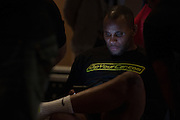 """Daniel """"DC"""" Cormier sits back stage before the official UFC 187 weigh-in event at the MGM Grand in Las Vegas, Nevada on May 22, 2015. (Cooper Neill)"""