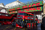 London buses pass each other under the railway bridge, over the A23 Brixton Road, on 30th January 2019, in London, England.