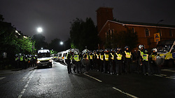 © Licensed to London News Pictures. 04/07/2020. London, UK.  Riot police react to a block party that moved through boroughs in west London ending in White City estate in the early hours of July 4th. A date that coincides with relaxing of social distancing rules, dubbed 'Super Saturday', permitting pubs and restaurants to serve alcohol for first time since restrictions were imposed earlier in the year, in response to the coronavirus pandemic. Photo credit: Guilhem Baker/LNP