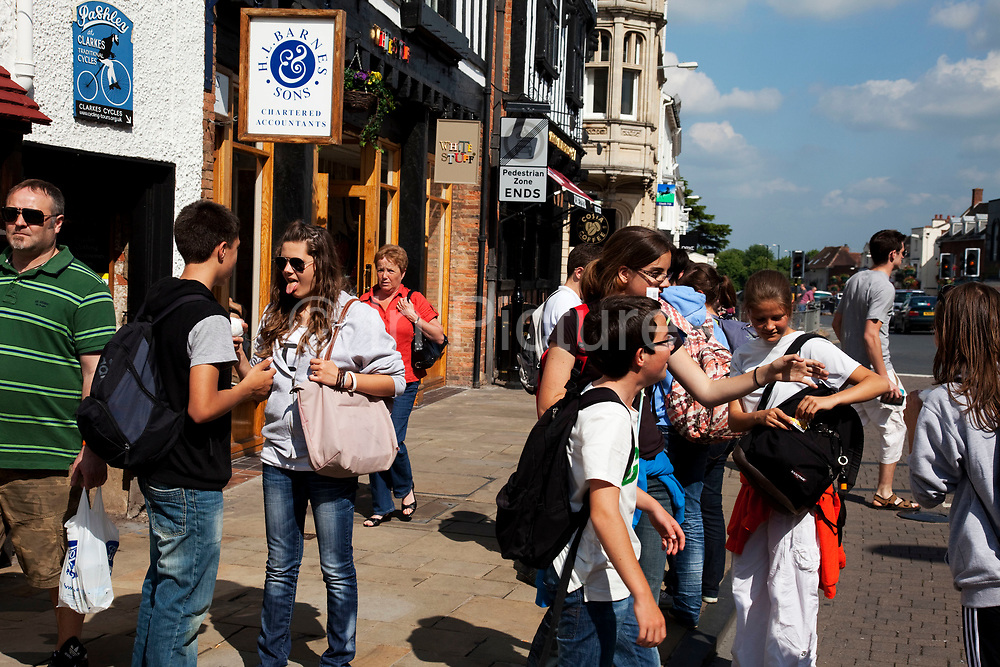Tourists in Stratford upon Avon, a small market town in the county of Warwickshire in central England. The town is a popular tourist destination owing to its status as birthplace of the playwright and poet William Shakespeare, receiving about three million visitors a year from all over the world.