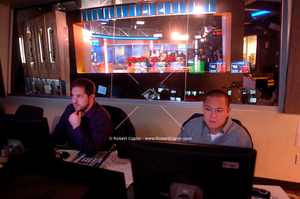"""From the NY1 Control Room, executive producer Matt Besterman, left, and producer Roger Chang prepare for a segment called """"In the Papers"""", that tells viewers what's in the morning newspapers."""