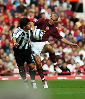 Fredrik Ljungberg<br />Arsenal 2005/06<br />BeLozoglu Emre Newcastle United<br />Arsenal V Newcastle United 14/08/05<br />The Premier League<br />Photo Robin Parker Fotosports International