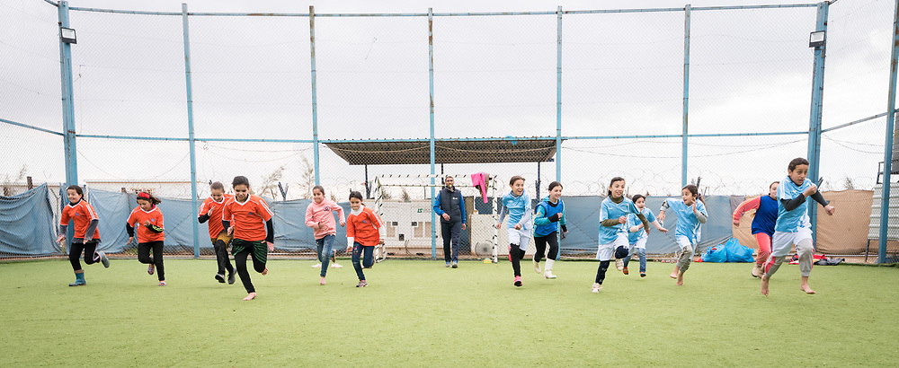 20 February 2020, Za'atari Camp, Jordan: Two teams take each other on in a speed competition during football practice for girls in the Peace Oasis, a Lutheran World Federation space in the Za'atari Camp where Syrian refugees are offered a variety of activities on psychosocial support, including counselling, life skills trainings and other activities.