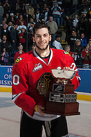 KELOWNA, CANADA - APRIL 25: Taylor Leier #20 of the Portland Winterhawks accepts the Western Conference trophy on April 25, 2014 during Game 5 of the third round of WHL Playoffs at Prospera Place in Kelowna, British Columbia, Canada. The Portland Winterhawks won 7 - 3 and took the Western Conference Championship for the fourth year in a row earning them a place in the WHL final.  (Photo by Marissa Baecker/Getty Images)  *** Local Caption *** Taylor Leier;