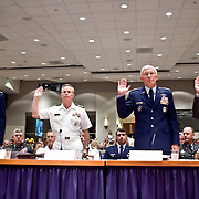 "The panel being sword in. From left: General Richard Myers, Chairman of the Joint Chiefs of Staff; Admiral Charles Joseph Leidig, Commandant of Mishipmen, United States Naval Academy, General Ralph Eberhart, Commander, NORAD and US Northern Command; Major General Larry Arnold (Ret.), Former Commander, Continental United States NORAD Region. Panel: Military Response on 9/11. The 9/11 Commission's 12th public hearing on ""The 9/11 Plot"" and ""National Crisis Management"" was held June 16-17, 2004, in Washington, DC."