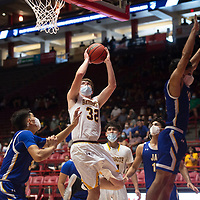 Rehoboth Lynx Jake Zylstra (32) drives to the basket against the Jal Panthers in the New Mexico Class 2A boys basketball state final at The Pit in Albuquerque Friday. Rehoboth Christian defeated Jal 55-50 to win the state championship.