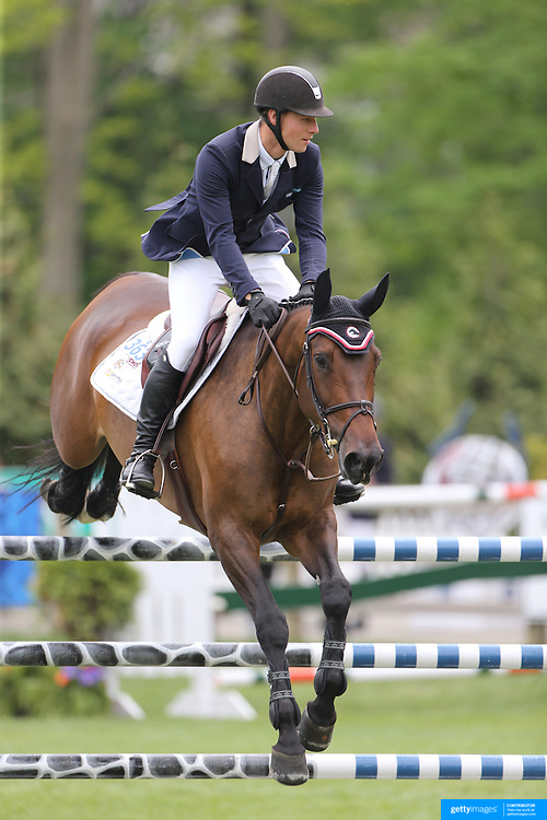 Marcel Wegfahrt riding Jolie Le Coer s in action during the $35,000 Grand Prix of North Salem presented by Karina Brez Jewelry during the Old Salem Farm Spring Horse Show, North Salem, New York, USA. 15th May 2015. Photo Tim Clayton