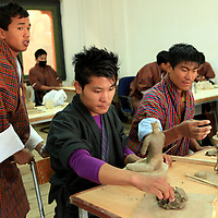 Asia, Bhutan, Thimpu. Sculpture student at the National Institute for Zorig Chusum, or traditional arts and crafts.