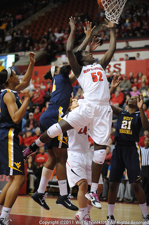 Rutgers Scarlet Knights forward Chelsey Lee (52) leaps for an offensive rebound during first half Big East NCAA women's basketball action between Rutgers and West Virginia at the Louis Brown Rutgers Athletic Center