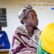 Listening carefully in class. Koumbadiouma, Kolda, Senegal.