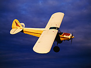 Andy Greenblatt performing a coordinated turn with his Piper PA18 Super Cub in skies east of Bettles, Alaska.