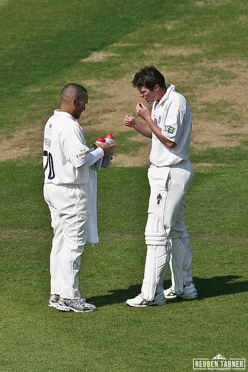 ©Reuben Tabner. 20/04/2011...Durham CCC v Sussex CCC.LV= County Championship..Gordon Muchall takes a stop for some tablets and a swig of water, brought to him by team mate Breese during his stint batting for Durham. ..Photo credit should read Reuben Tabner