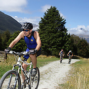 Competitors in action during the bike leg of the Paradise Triathlon and Duathlon series, Paradise, Glenorchy, South Island, New Zealand. 18th February 2012. Photo Tim Clayton