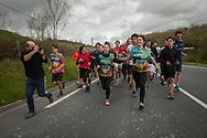 """People run on the 20th Korrika. Lezo (Basque Country). April 4, 2017. The """"Korrika"""" is a relay course, with a wooden baton that passes from hand to hand without interruption, organised every two years in a bid to promote the basque language. The Korrika runs over 11 days and 10 nights, crossing many Basque villages and cities. This year was the 20th edition and run more than 2500 Kilometres. Some people consider it an honour to carry the baton with the symbol of the Basques, """"buying"""" kilometres to support Basque language teaching. (Gari Garaialde / Bostok Photo)"""