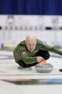 Kevin Koe, skip on Kevin Koe's team throws his rock in the team's first draw Wednesday.  The 2011 GP Car and Home Players' Championship ran April 12-17 at the Crystal Centre, Grande Prairie, AB..11-04-13, Photo Randy Vanderveen, Grande Prairie, Alberta.