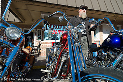 Willie takes a brief pause in the hecticness of his annual Tropical Tattoo Old School Bike Show during Daytona Bike Week. FL, USA. March 13, 2014.  Photography ©2014 Michael Lichter.