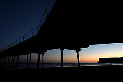 (c) Licensed to London News Pictures. 04/12/2015<br /> Saltburn. UK. <br /> Saltburn pier can be seen as the first light of day rises up over the cliffs of Huntcliff.<br /> Photo credit : Ian Forsyth/LNP