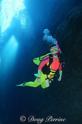 diver descends into the slot at The Keyhole, one of Hawaii's best dive sites, Lehua Rock ( near Niihau Island, off Kauai ), Hawaii, USA ( Central Pacific Ocean ) MR 305