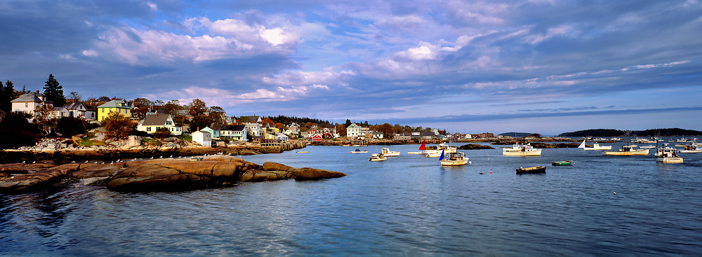 Blue-grey clouds sweep over the harbor of Stonington, Deer Island, Maine.