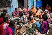 A group of young women are decorating glass bracelets inside a house transformed into a small-scale workshop in the slum surrounding Firozabad, renowned as the 'glass city', in Uttar Pradesh, northern India. Due to extreme poverty, over 20.000 young children are employed to complete the bracelets produced in the industrial units. This area is considered to be one of the highest concentrations of child labour on the planet. Forced to work to support their disadvantaged families, children as young as five are paid between 30-40 Indian Rupees (approx. 0.50 EUR) for eight or more hours of work daily. Most of these children are not able to receive an education and are easily prey of the labour-poverty cycle which has already enslaved their families to a life of exploitation. Children have to sit in crouched positions, use solvents, glues, kerosene and various other dangerous materials while breathing toxic fumes and spending most time of the day in dark, harmful environments. As for India's Child Labour Act of 1986, children under 14 are banned from working in industries deemed 'hazardous' but the rules are widely flouted, and prosecutions, when they happen at all, get bogged down in courts for lengthy periods. A ban on child labour without creating alternative opportunities for the local population is the central problem to the Indian Government's approach to the social issue affecting over 50 million children nationwide.