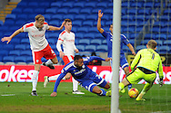 Cardiff City's Kenneth Zohore (on ground) has his shot saved by Barnsley goalkeeper Adam Davies (1). EFL Skybet championship match, Cardiff city v Barnsley at the Cardiff city stadium in Cardiff, South Wales on Saturday 17th December 2016.<br /> pic by Carl Robertson, Andrew Orchard sports photography.