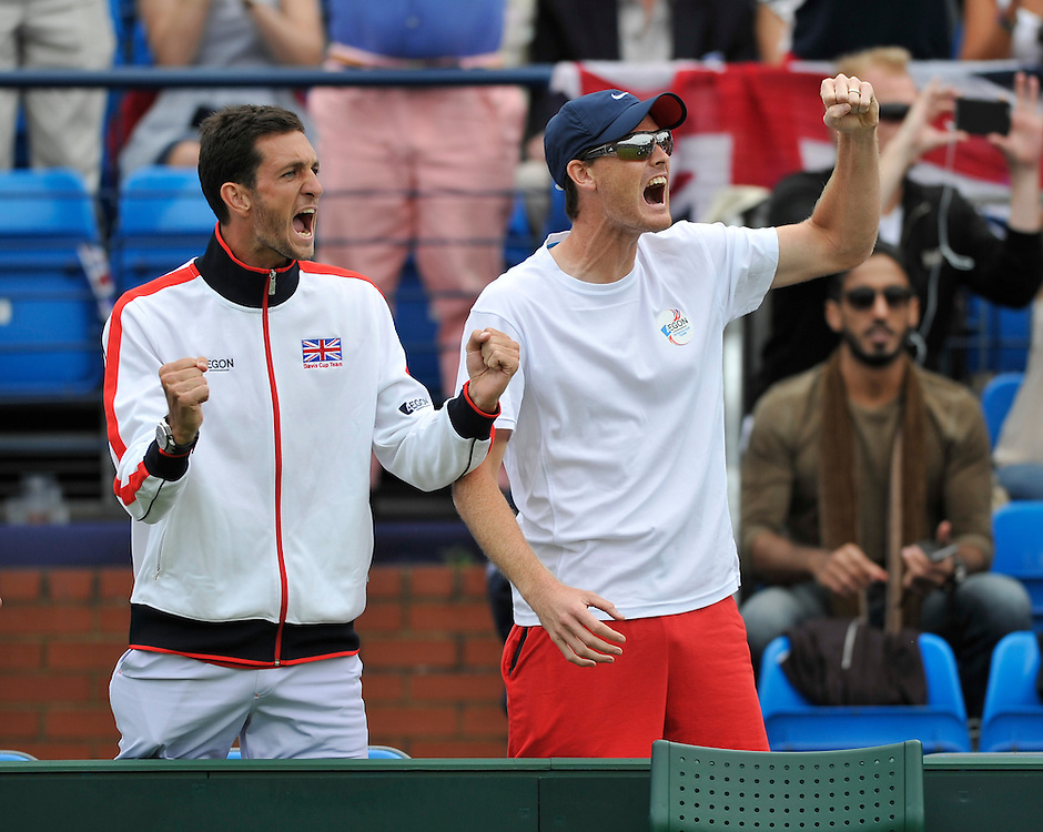 James Ward (left) and Jamie Murray celebrate as Andy Murray takes the 2nd set  over Jo-Wilfried Tsonga - Andy Murray (GBR) def Jo-Wilfried Tsonga (7-5, 7-6, 6-2)<br /> <br /> Photographer Ashley Western/CameraSport<br /> <br /> International Tennis - 2015 Davis Cup by BNP PARIBAS - World Group Quarterfinals - Great Britain v France - Day 1 - Friday 17th July 2015 - Queens Club - London<br /> <br /> © CameraSport - 43 Linden Ave. Countesthorpe. Leicester. England. LE8 5PG - Tel: +44 (0) 116 277 4147 - admin@camerasport.com - www.camerasport.com.