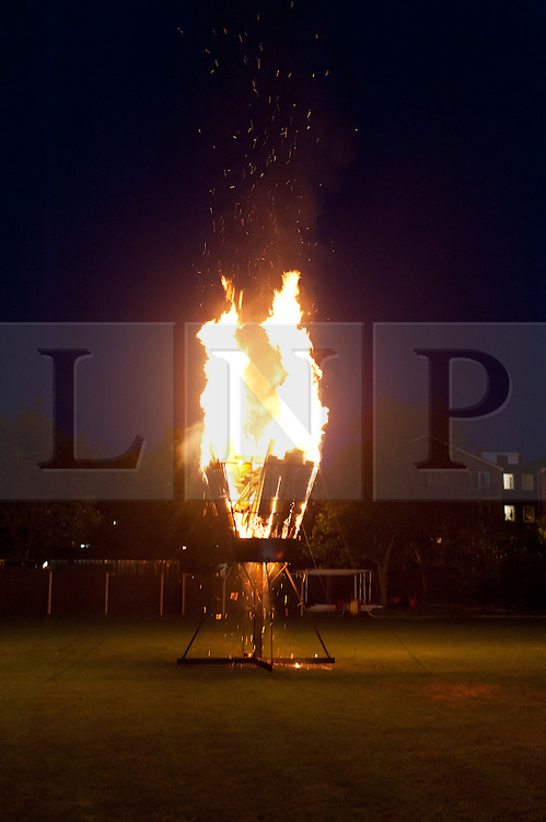 © Licensed to London News Pictures. 04/06/2012. London, UK.   A Jubilee Beacon burns at Kings College School, Wimbledon, London.  A network of over 4000 Beacons was lit by communities and others throughout the United Kingdom, Channel Islands and the Isle of Man, along with the Commonwealth.  The Royal Jubilee celebrations. Great Britain is celebrating the 60th  anniversary of the countries Monarch HRH Queen Elizabeth II accession to the throne this weekend.  Photo credit : Richard Isaac/LNP