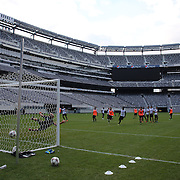 Mario Balotelli, scores a brilliant free kick during training with AC Milan in preparation for the Guinness International Champions Cup tie with Chelsea at MetLife Stadium, East Rutherford, New Jersey, USA.  3rd August 2013. Photo Tim Clayton