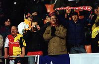 Arsenal fans cheer their team on during the match. Shakhtar Donetsk 3:0 Arsenal, UEFA Champions League, Group B, Centralny Stadium, Donetsk, Ukraine, 7/11/2000. Credit Colorsport / Stuart MacFarlane.
