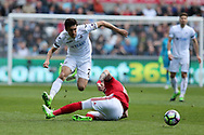 Jack Cork of Swansea city jumps over the tackle from Alvaro Negredo of Middlesbrough .Premier league match, Swansea city v Middlesbrough at the Liberty Stadium in Swansea, South Wales on Sunday 2nd April 2017.<br /> pic by Andrew Orchard, Andrew Orchard sports photography.