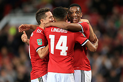 20th September 2017 - Carabao Cup (3rd Round) - Manchester United v Burton Albion - Ander Herrera of Man Utd (L) and teammate Anthony Martial (R) congratulate goalscorer Jesse Lingard after he scored their 2nd goal - Photo: Simon Stacpoole / Offside.