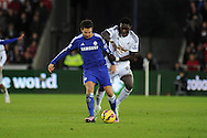 Cesc Fabregas of Chelsea breaks away from Bafetimbi Gomis of Swansea city.Barclays Premier League match, Swansea city v Chelsea at the Liberty Stadium in Swansea, South Wales on Saturday 17th Jan 2015.<br /> pic by Andrew Orchard, Andrew Orchard sports photography.