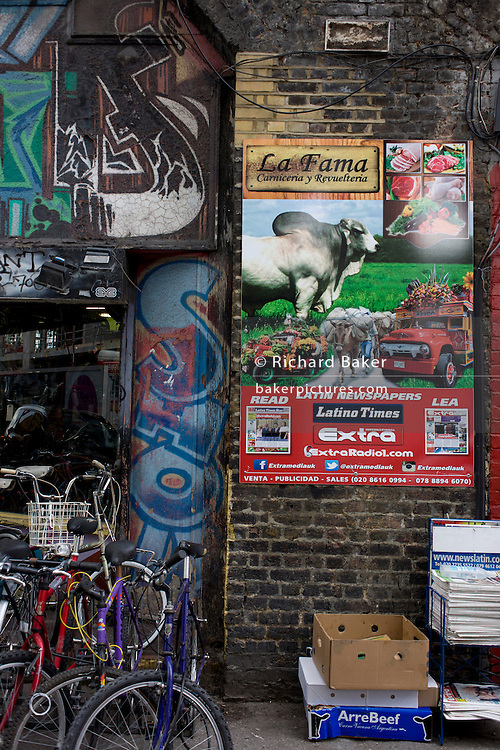 A Latino ad for a Spanish language newspaper and local bike business at Elephant & Castle, where massive regeneration is due.