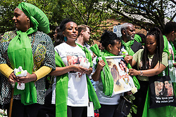 London, UK. 14th June, 2018. Family members prepare to release doves of peace outside St Helen's Church to mark the first anniversary of the Grenfell Tower Fire.