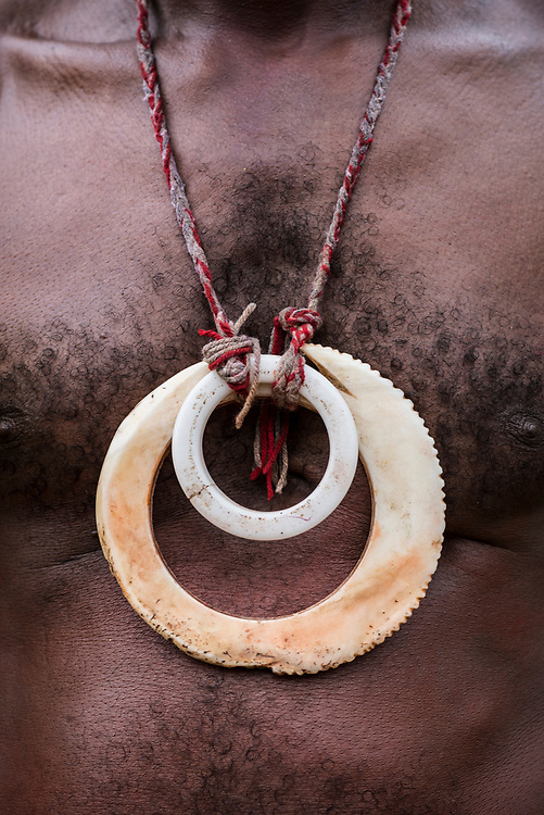 A man in Papua New Guinea wears a traditional necklace during a celebration in a village near the mouth of the Ramu River in Madang Province, Papua New Guinea